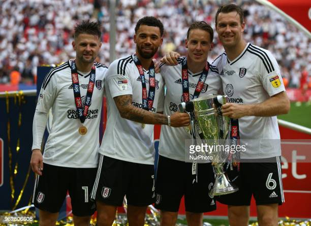 LR Fulham's Tom Cairney Fulham's Ryan Fredericks Fulham's Stefan Johansen and Fulham's Kevin McDonald with Trophy during the Championship PlayOff...