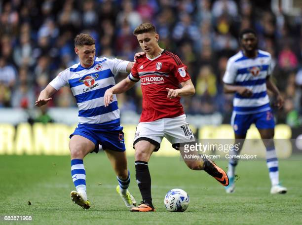 Fulham's Tom Cairney holds off the challenge from Reading's George Evans during the Sky Bet Championship PlayOff Semi Final Second Leg match between...