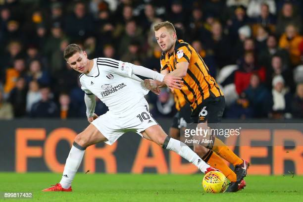 Fulham's Tom Cairney keeps the ball from Hull City's Sebastian Larsson during the Sky Bet Championship match between Hull City and Fulham at KCOM...
