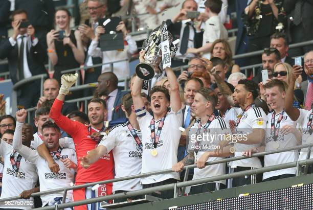 Fulham's Tom Cairney lifts the Championship Play Off Final trophy during the Sky Bet Championship Play Off Final match between Aston Villa and Fulham...