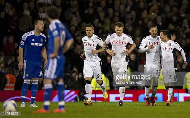 Fulham's US midfielder Clint Dempsey celebrates Fulham's AustrianSwiss midfielder Kerim Frei after scoring the equaliser during the English Premier...