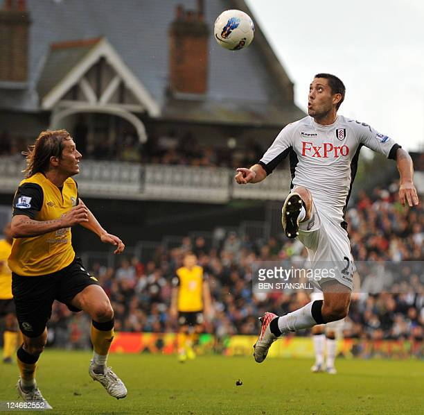 Fulham's US midfielder Clint Dempsey fights for the ball with Blackburn Rovers' Michel Salgado during their Premiership match at Craven Cottage in...