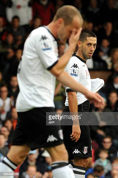Fulham's US midfielder Clint Dempsey looks on as English midfielder Danny Murphy gestures after missing a chance during the English Premier League...