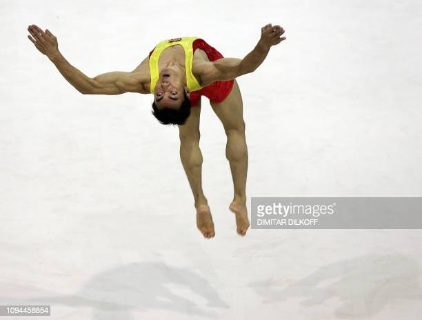 Fuliang Liang of China competes on the floor during the men's team finals at the Arena in Aarhus 17 October 2006 at the 39th Artistic Gymnastics...