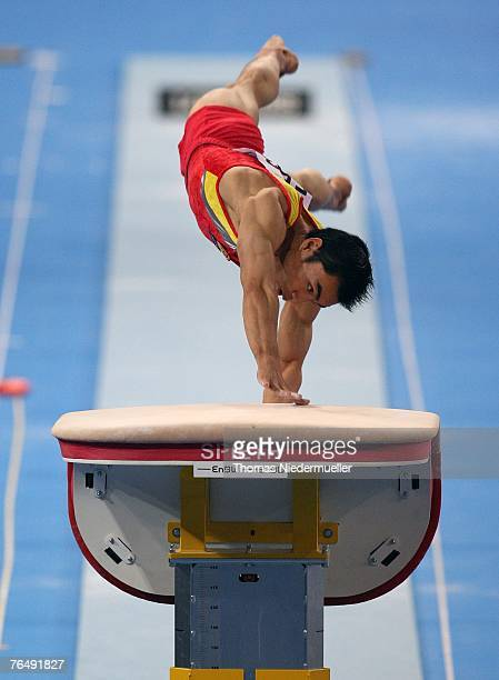 Fuliang Liang of China performs on the vault during the men's qualifications of the 40th World Artistic Gymnastics Championships on September 3 2007...
