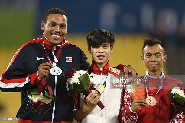 Fuliang Liu of China poses with his gold medal, Roderick Townsend-Roberts of USA silver, Setiyo Budihartanto of Indonesia bronze for the men's long...