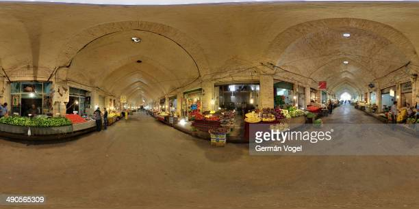 Full 360° panoramic view of the fruit and vegetables section of the Kermanshah bazaar or traditional market, in the middle of long brick-vaulted...