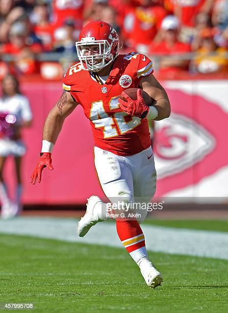 Full back Anthony Sherman of the Kansas City Chiefs rushes for a first down against the St Louis Rams during the second half on October 26 2014 at...