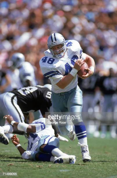 Full back Daryl Johnston of the Dallas Cowboys rushes for yards during a preseason game against the Oakland Raiders at Oakland/Alameda County...