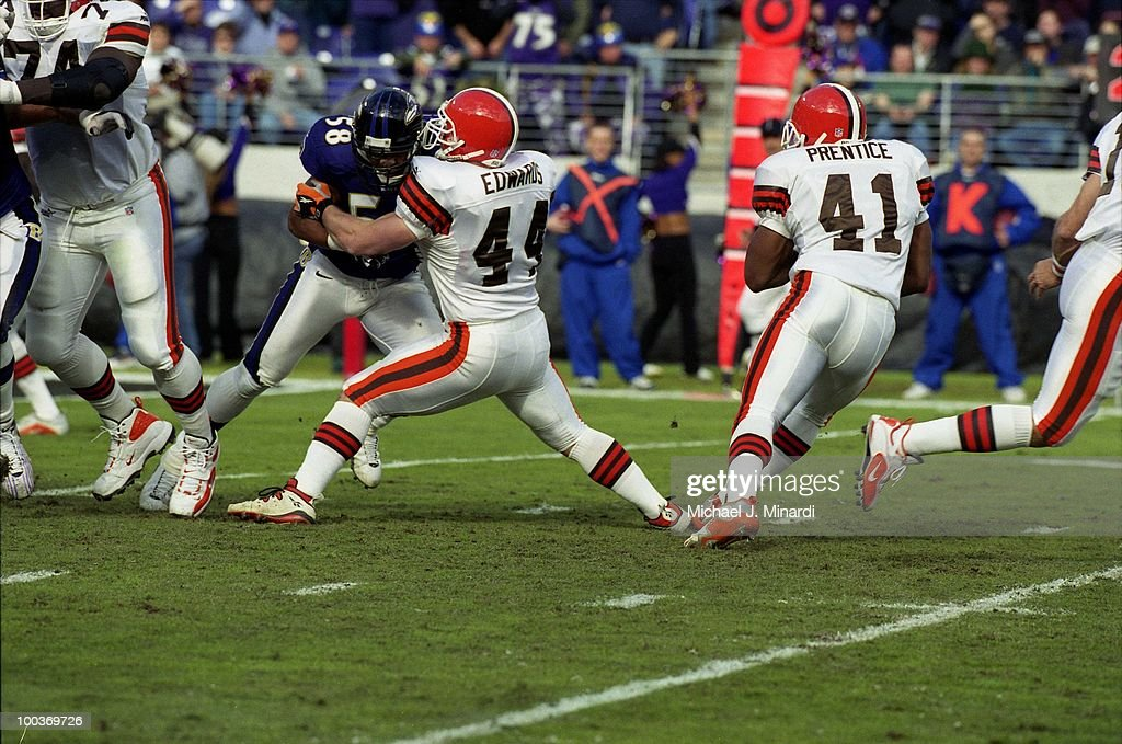 Full Back Marc Edwards #44 of the Cleveland Browns blocks Line Backer Peter Boulware #58 of the Baltimore Ravens so that Running Back Travice Prentice #41of the Browns can make some yardage in a NFL game at PSINet Ravens Stadium on November 26, 2000 in Baltimore, Maryland. The Ravens won 44 to 7.