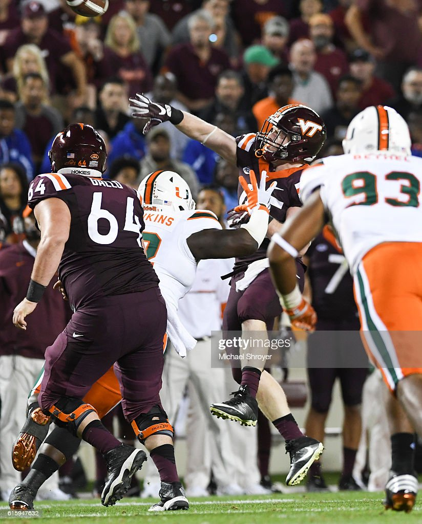 Full back Sam Rogers #45 of the Virginia Tech Hokies throws a touchdown pass against the Miami Hurricanes in the second half at Lane Stadium on October 20, 2016 in Blacksburg, Virginia. Virginia Tech defeated Miami 37-16.