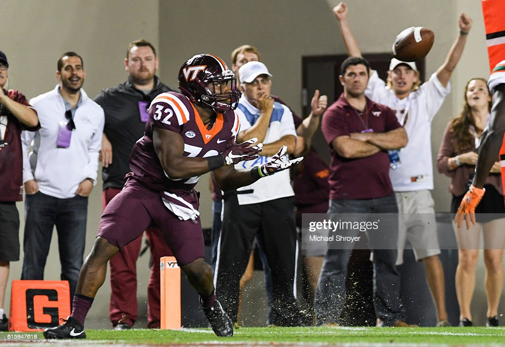 Full back Steven Peoples #32 of the Virginia Tech Hokies catches a touchdown pass against the Miami Hurricanes in the second half at Lane Stadium on October 20, 2016 in Blacksburg, Virginia. Virginia Tech defeated Miami 37-16.