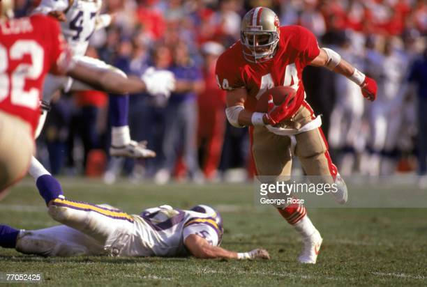 Full back Tom Rathman of the San Francisco 49ers runs with the ball during the 1989 NFC Divisional Playoff game against the Minnesota Vikings at...