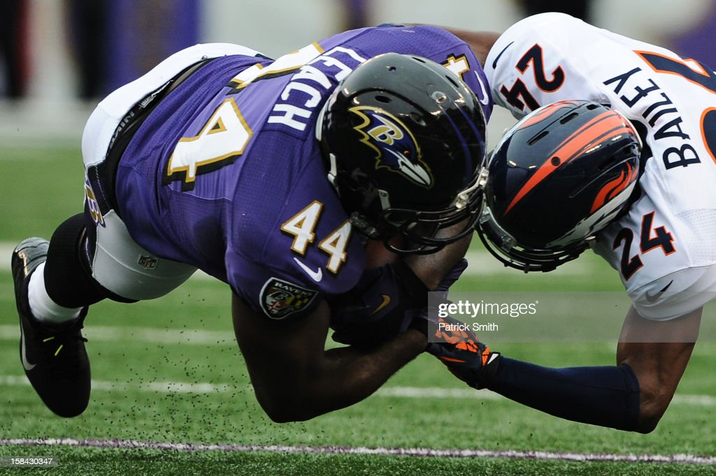 Full back Vonta Leach #44 of the Baltimore Ravens is hit by cornerback Champ Bailey #24 of the Denver Broncos in the first quarter at M&T Bank Stadium on December 16, 2012 in Baltimore, Maryland.