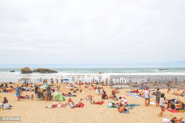 full beach - crowded beach stock pictures, royalty-free photos & images
