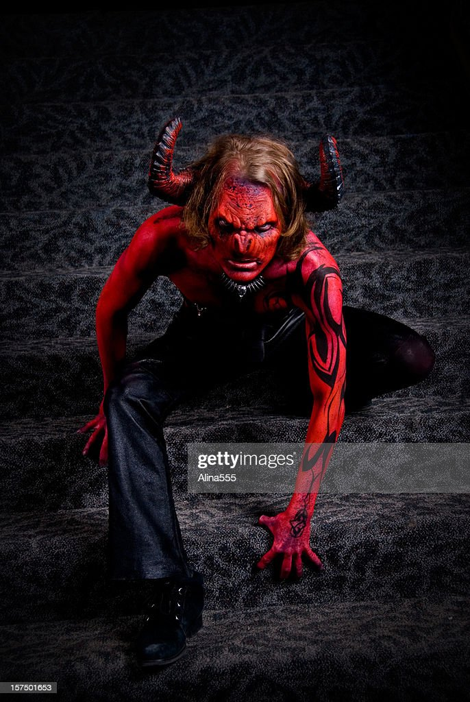 Full body image of a man in devil's costume : Stock Photo