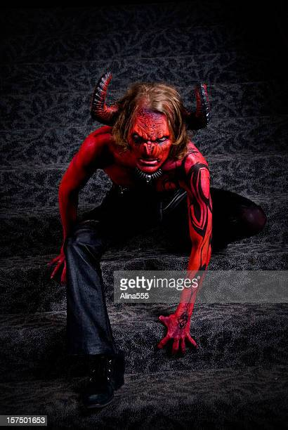full body image of a man in devil's costume - devil costume stock photos and pictures