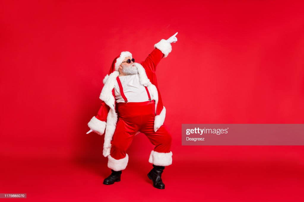 Full body photo of overweight carefree delightful ecstatic active energetic listening hip-hop music chic grandfather pointing finger up enjoying rhythm movement has big belly isolated vivid background : Stock Photo