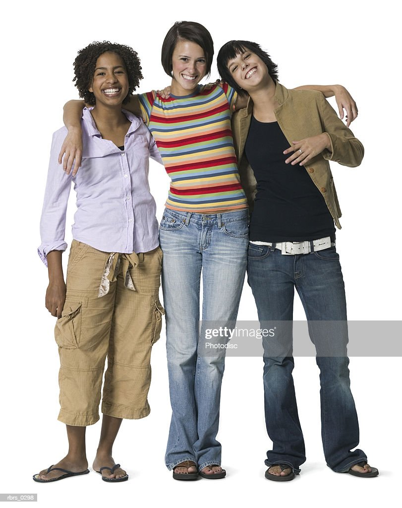 full body portrait of three teenage female friends they put their arms around each other and smile : Foto de stock