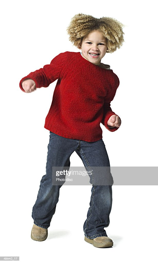 full body shot of a curly haired female child as she playfully dances : Stockfoto