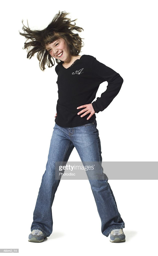 full body shot of a female child as she dances and tosses her hair from side to side : Stockfoto