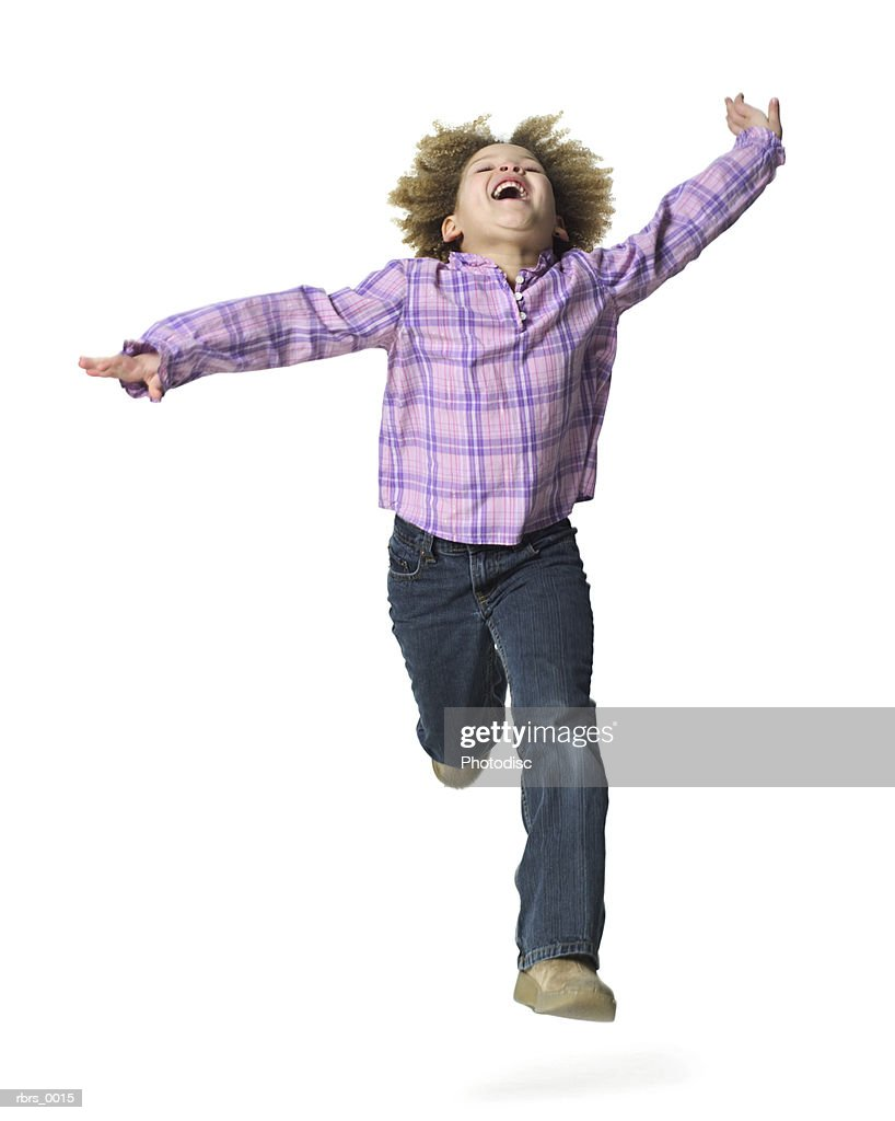 full body shot of a female child as she runs forward and throws her head back : Foto de stock
