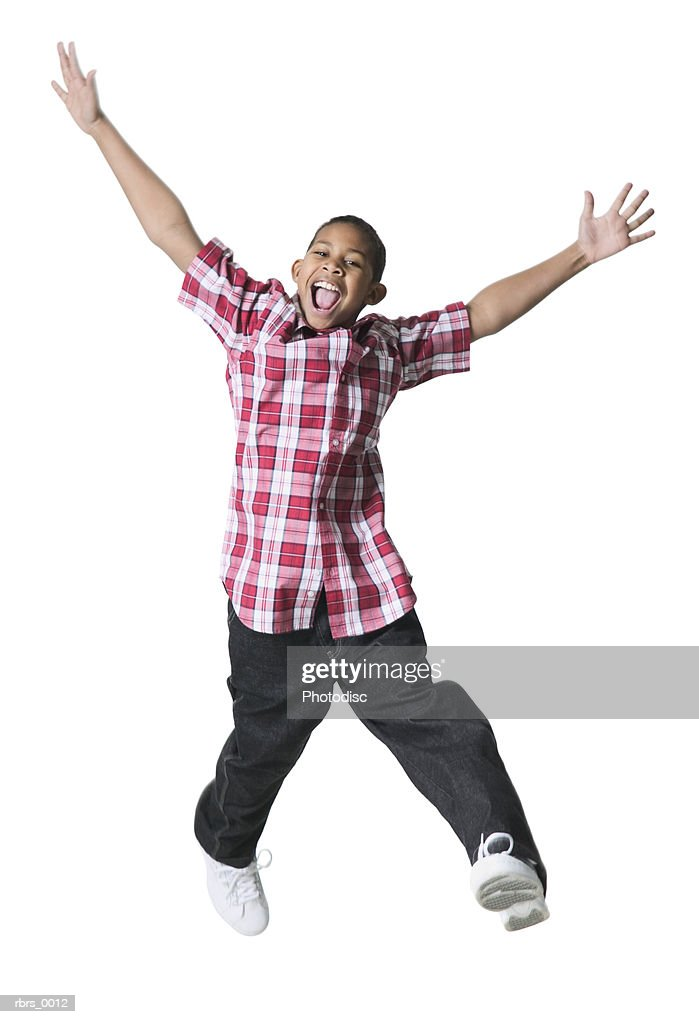 full body shot of a male child as he jumps up and flies through the air : Stock Photo