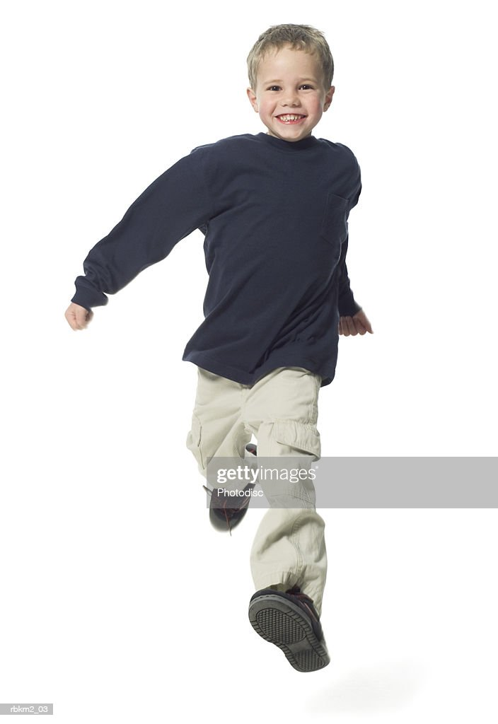 full body shot of a male child as he runs playfully toward the