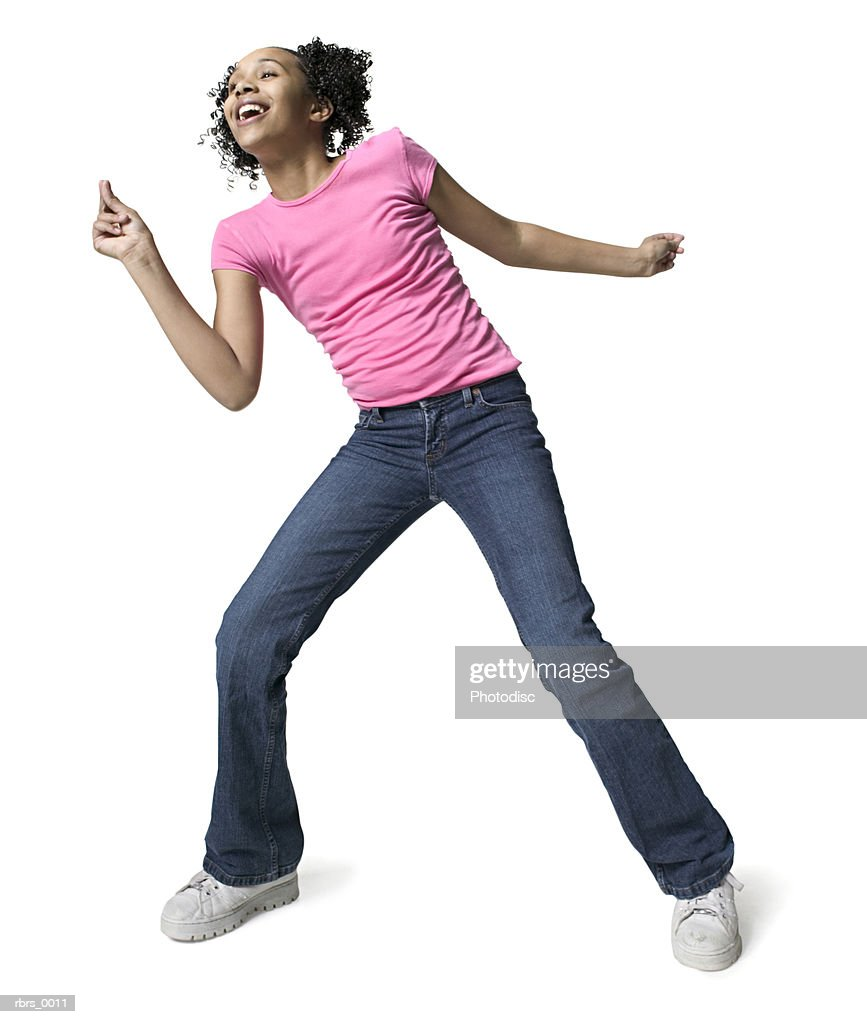 full body shot of a teenage female as she dances around playfully : Foto de stock