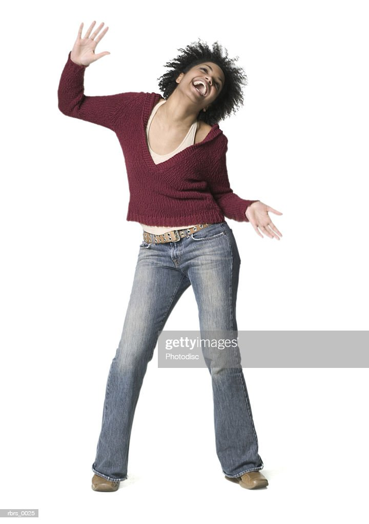 full body shot of a young adult woman as she swings her shoulders all around : Foto de stock