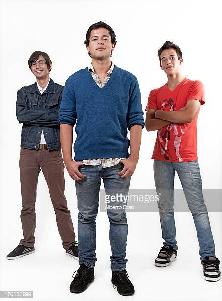 full body studio portrait of three young men - tres personas fotografías e imágenes de stock