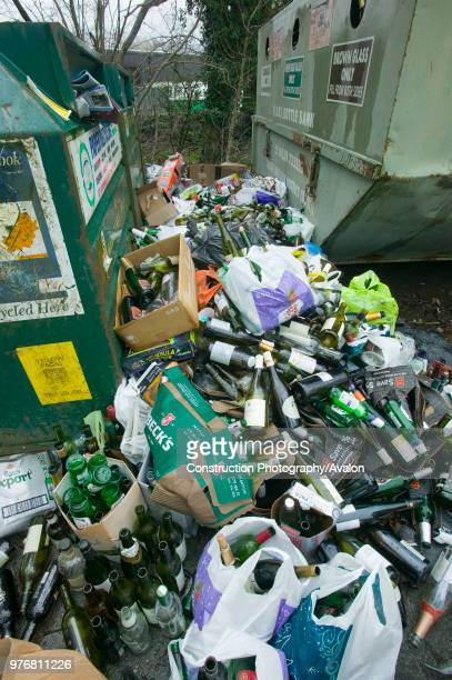 Full bottle bank overflowing with bottles to be recycled Ambleside UK.