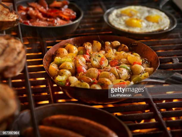 full breakfast on the bbq - prepared potato stock pictures, royalty-free photos & images