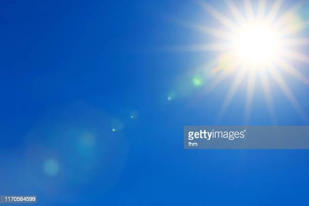 full bright sun in the sky - sunlight stock-fotos und bilder
