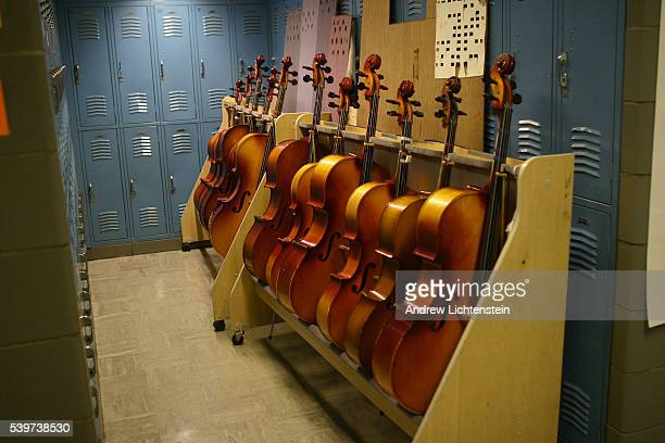 A full cello rack outside the orchestra room at the KIPP Academy in the South Bronx part of a network of public middle schools that is becoming a...
