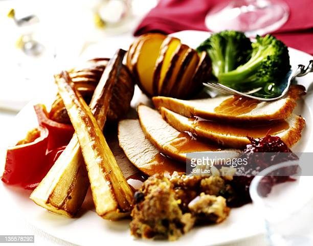 full christmas dinner with roasted vegetables - evening meal stock pictures, royalty-free photos & images