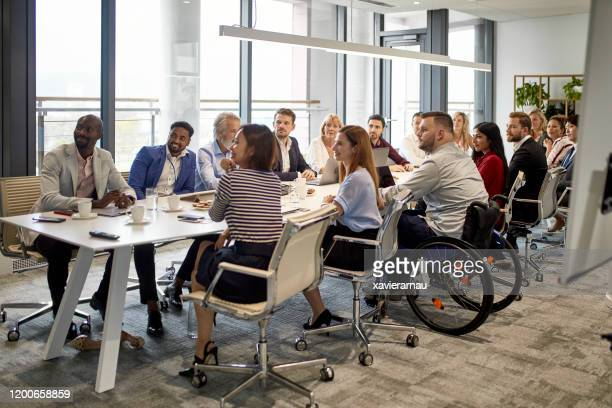 full complement of executives at management meeting - diversity stock pictures, royalty-free photos & images