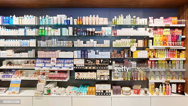 Full cosmetics shelves in a german pharmacy showing many products