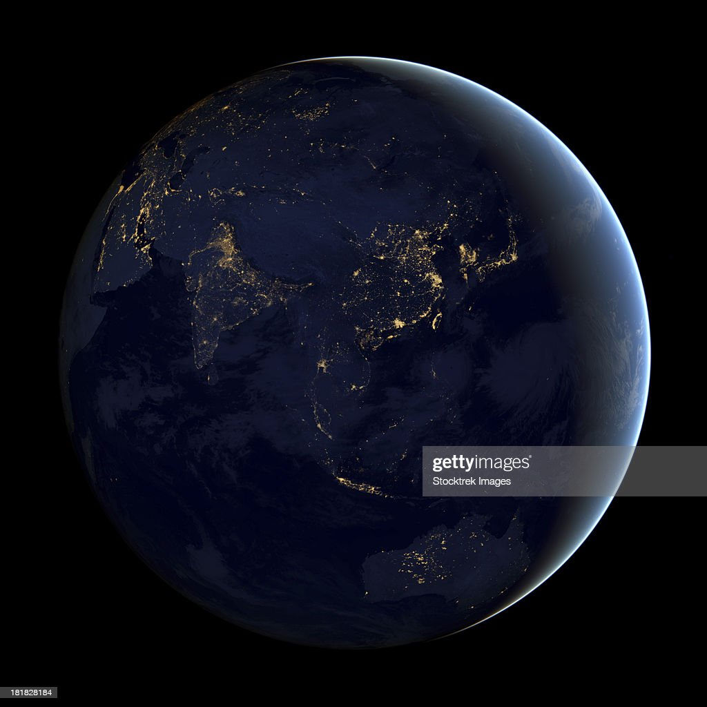 Full Earth at night showing city lights of Asia and Australia. : Stock Photo