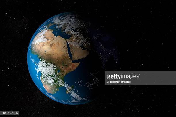Full Earth showing simulated clouds over Africa. The lighting of this scene is completely artistic and not scientifically accurate.