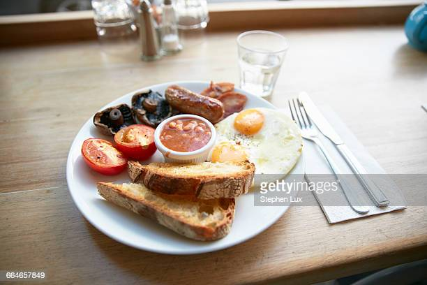 Full English breakfast on counter in cafe