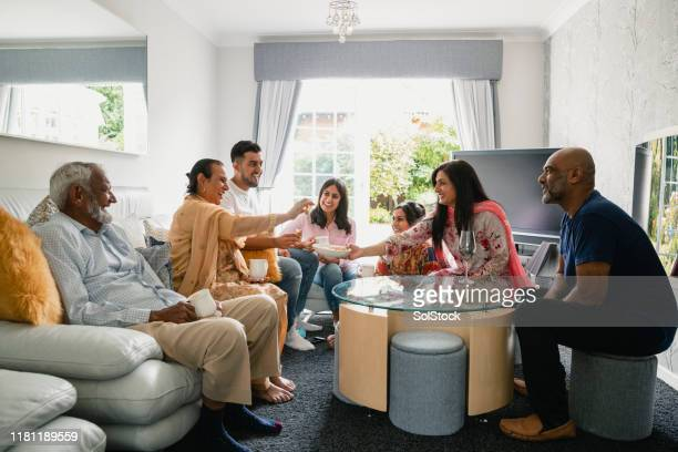 full family togetherness - indian ethnicity stock pictures, royalty-free photos & images