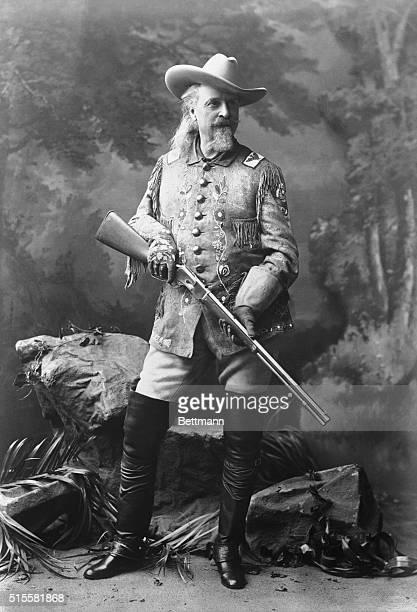 Full figure of William Cody with gun Undated B/W photograph