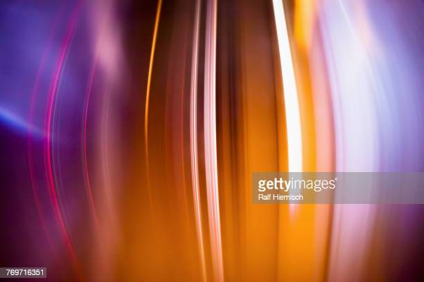Full frame abstract image of orange light trails