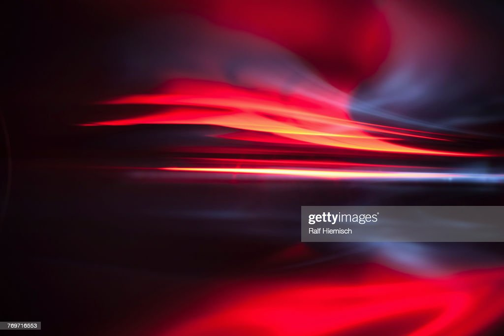 Full frame abstract image of vibrant red light trails : Stock Photo