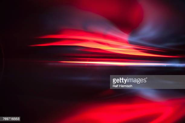 full frame abstract image of vibrant red light trails - motion blur stock photos and pictures