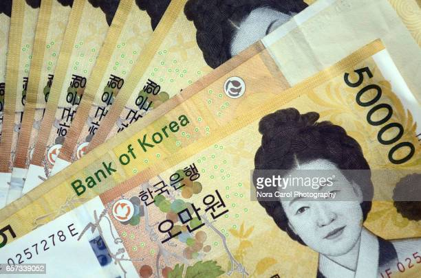 full frame and high angle view of 50000 korean won - korean currency stock photos and pictures