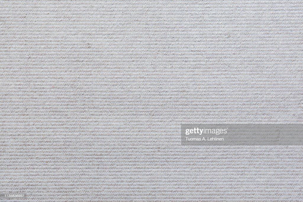 Full frame background of a light, almost white, carpet viewed from above. : Stock-Foto
