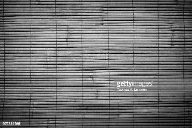 full frame background of aged wooden bamboo blinds in black and white with vignette. they are popular in asia. - black bamboo stock pictures, royalty-free photos & images