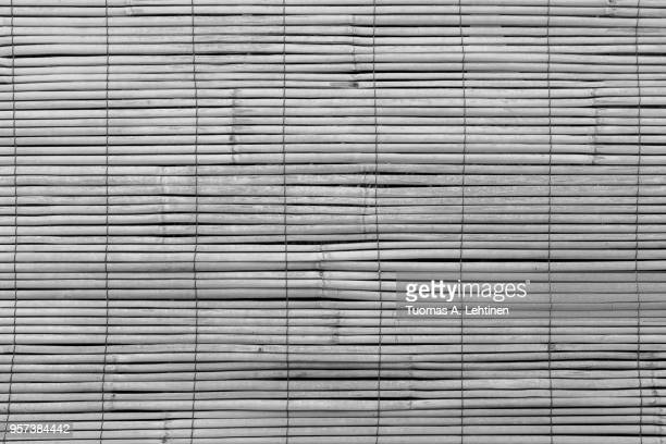 full frame background of aged wooden bamboo blinds, popular in asia, in black and white - black bamboo stock pictures, royalty-free photos & images